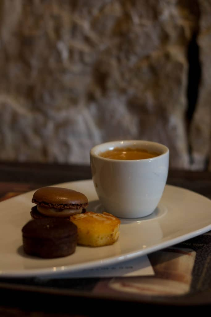 Espresso coffee with sweet treats suggest the bittersweetness of risk.